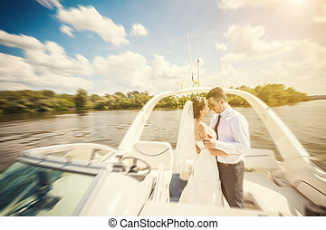 Bride and groom on a yacht - The wedding ceremony beautiful...