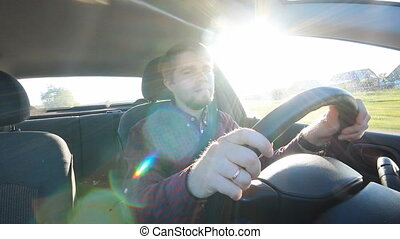 The young man behind the wheel happy