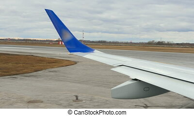 Before take-off - Airplane taxiing on runway before...