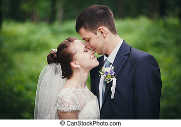 bride and groom in the park - The wedding ceremony beautiful...