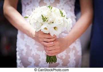 flowers in the brides hands - The wedding ceremony beautiful...