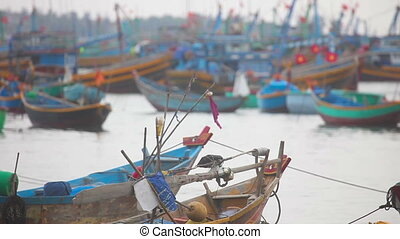Fisher boats - Colored fishing boats floating in the...