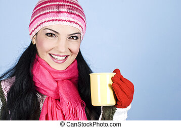 Happy winter woman holding hot drink - Portrait of happy...
