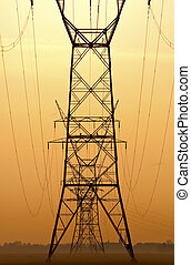 Powerlines - Lined up powerlines at sunset with upcoming...