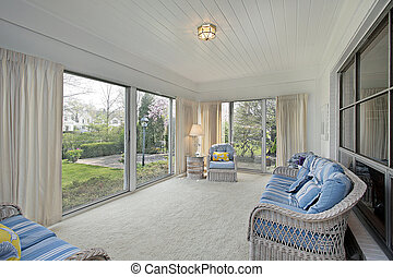 Sunroom with patio view - Sunroom in suburban home with...