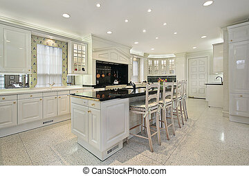 Kitchen with black top marble island