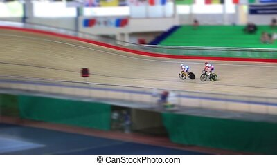 Pursuit on the cycling track - Bicycle Race tracking shot...