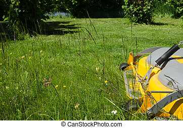 Lawncare with a riding mower - Detail of lawncare with a...