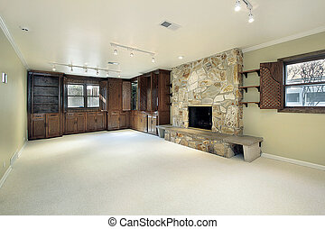 Family room with stone fireplace - Family room in suburban...