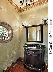 Powder room with rounded window - Powder room in luxury home...