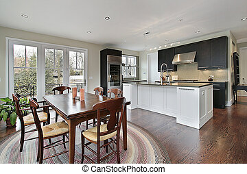 Kitchen with eating area - Kitchen in luxury home with...