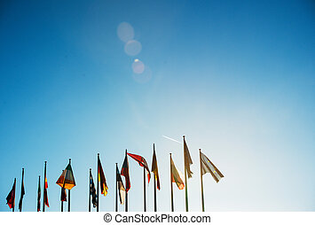 All EU Flags on clear sky - Flags in front of the European...