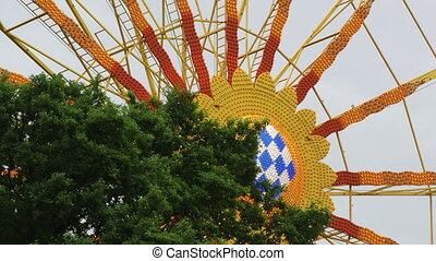 Ferris Wheel in Carousel Amusement Park and Tree