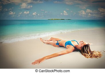 Relax and sunbathing - Girl tan lying seashore on the sand