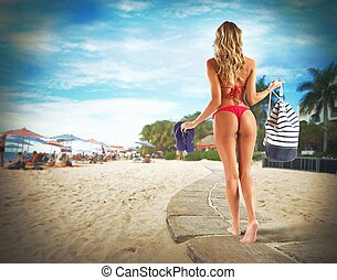 Bikini girl walking with bag and thong