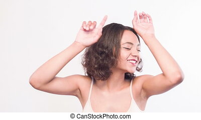 Mulatto girl dancing on isolated white background - Feel...