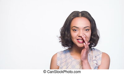 Shy mulatto girl covering her face with hand - I have news...