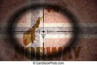 sniper scope aimed at the vintage norwegian flag and map