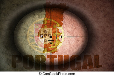 sniper scope aimed at the vintage portuguese flag and map