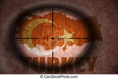 sniper scope aimed at the vintage turkish flag and map