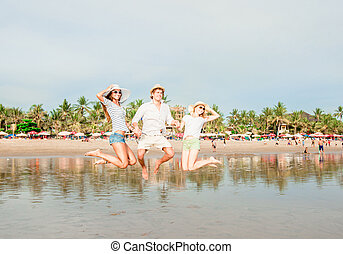 Group of happy young people having great time on the beach -...