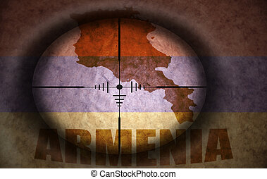 sniper scope aimed at the vintage armenian flag and map