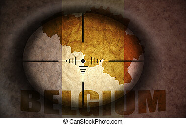 sniper scope aimed at the vintage belgian flag and map