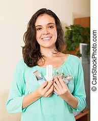 Girl holding lightbulbs