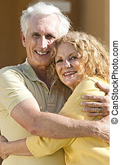Senior Man and Woman Couple Hugging and Happy Together
