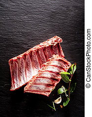 Raw Boar Spare Ribs with Fresh Herbs