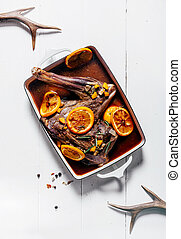Venison haunch cooked with oranges and red wine - Venison...