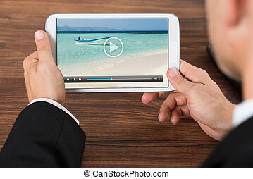 Businessperson Watching Video On Mobile Phone - Close-up Of...