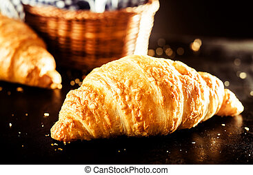 Buttery and Flaky Delicious Croissant on the Table - Close...