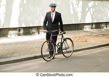 Male Cyclist With His Bicycle On Road - Male Cyclist Wearing...