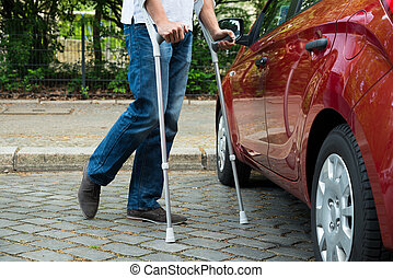 Disabled Man With Crutches Walking Near Care