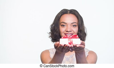 Mulatto girl smiling with present