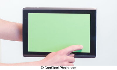 Girl clicking on tablet - What is there. Close-up of girl...