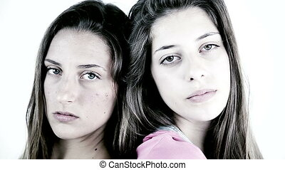 two serious sad female teenager - Portrait of two serious...