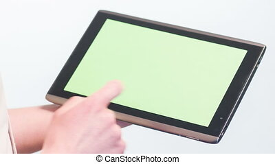 Pointing, clicking on tablet with green background