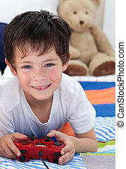 Little boy playing videos games