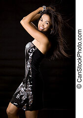 dancing woman - pretty brunette woman having fun on black...