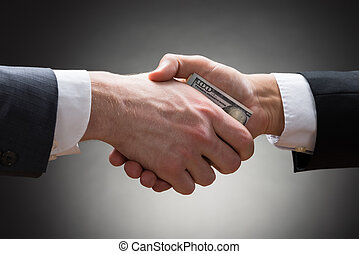 Businesspeople Hands With Money - Close-up Of Two...