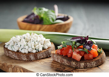 homemade bruschetta with tomatoes, basil and leek on olive...