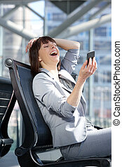 Business woman reading text message on mobile phone -...