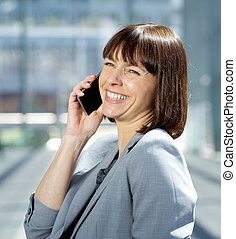 Happy business woman talking on mobile phone - Profile...
