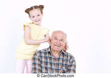 Grandfather with his grand daughter - Portrait of a...