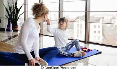 Mother and daughter - Mom shows daughter how to do...