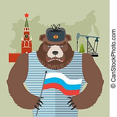 Bear with ear flaps with flag of Russia Background of Moscow...