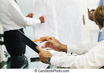Business meeting - Detail of four people attending a...