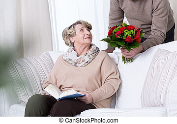 Man giving bouquet of red roses - Man giving his wife...